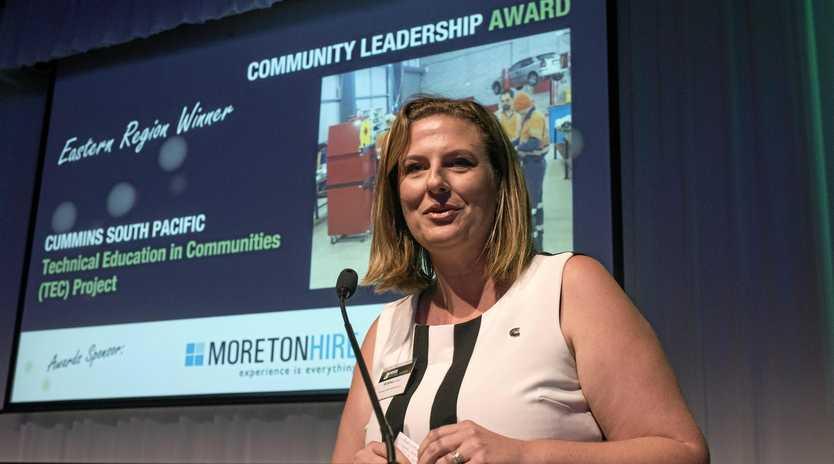 SUCCESS STORY: Kristina Lambkin accepts an award for community leadership at the HVIA dinner in Brisbane.