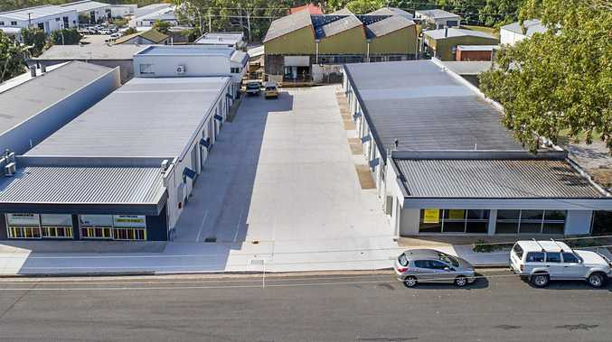 The final two units in a Moffat Beach industrial development have sold at auction for more than $500,000.