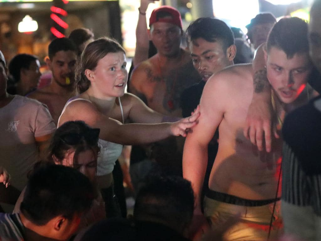 A young Australian woman tries to intervene during an incident in  Bali. Picture: Liam Kidston