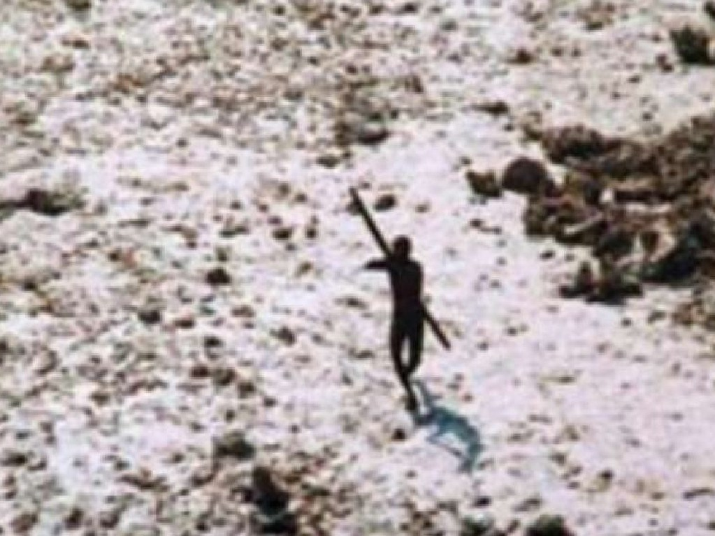 A Sentinelese tribesman points a spear at an overflying helicopter sent to inspect damage in the wake of the 2004 tsunami. Picture: Indian Coastguard/ Survival International