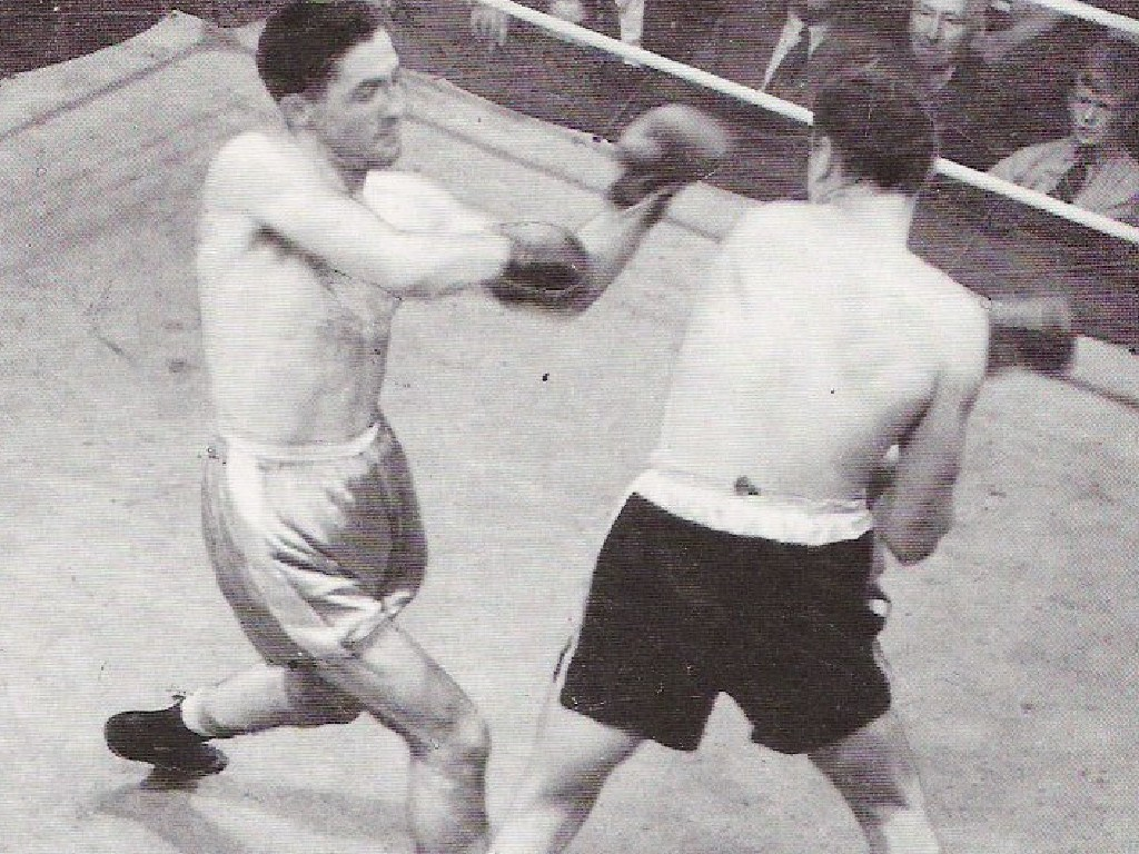 Vic Patrick (left) taking on Tommy Burns.