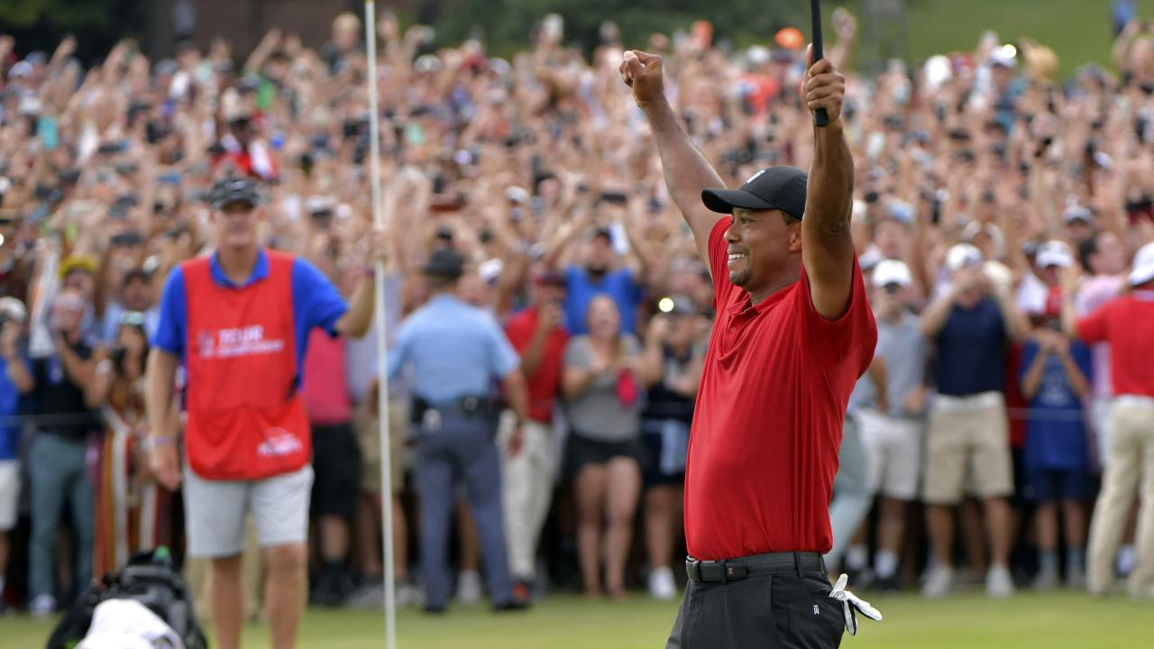 Tiger Woods celebrates after on the 18th green after winning the Tour Championship golf tournament in Atlanta.