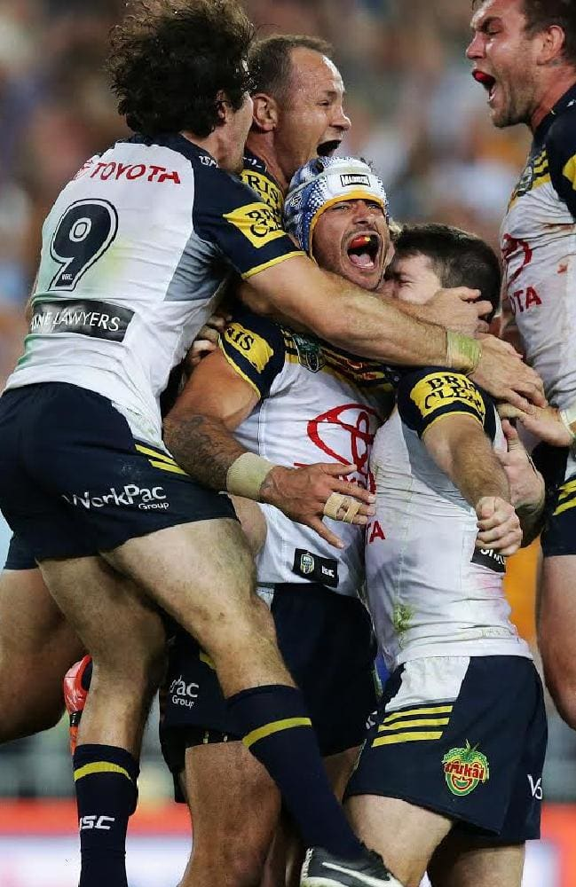 Johnathan Thurston and his Cowboys teammates after winning the 2015 NRL Premiership. Picture: Brett Costello