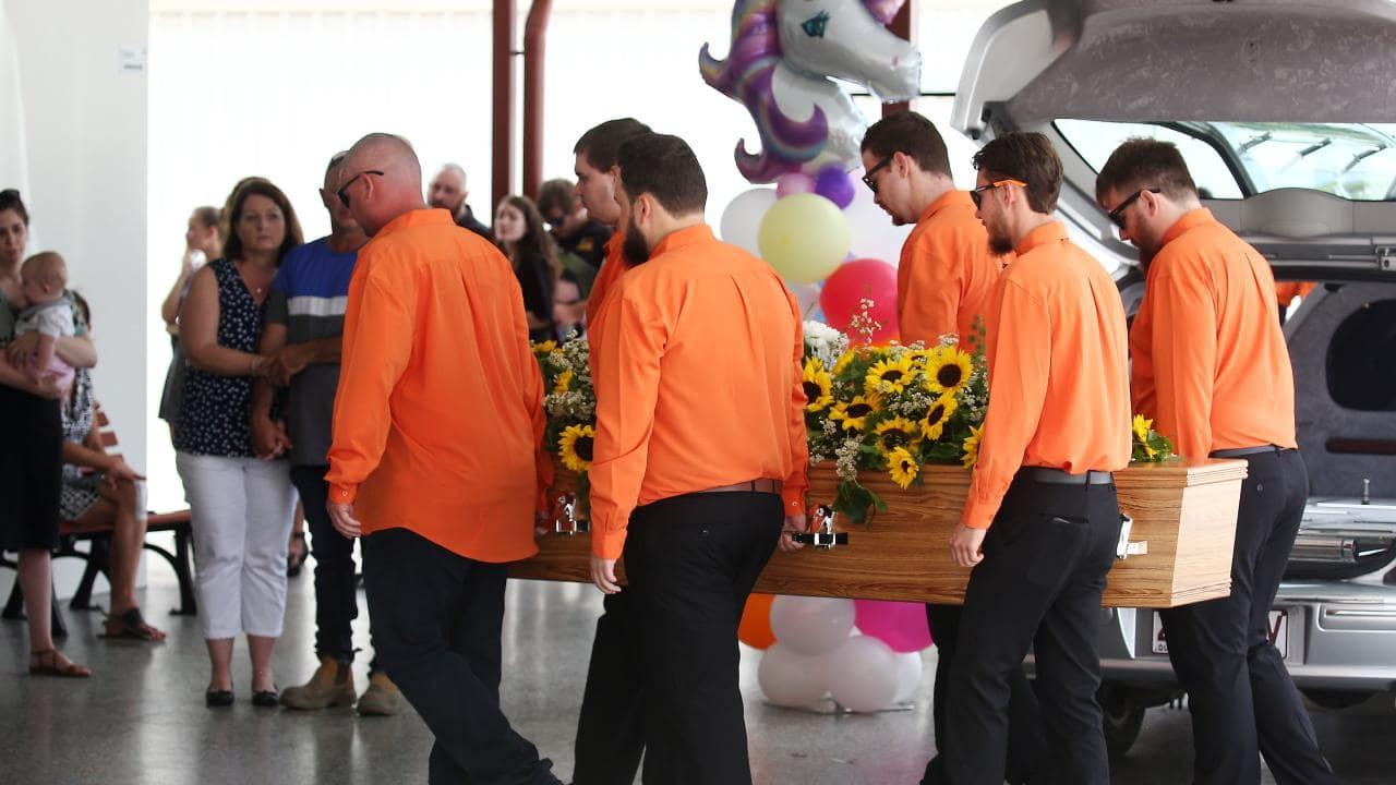 Pallbearers dressed in orange carry Toyah's casket into the chapel to start the service. PICTURE: BRENDAN RADKE