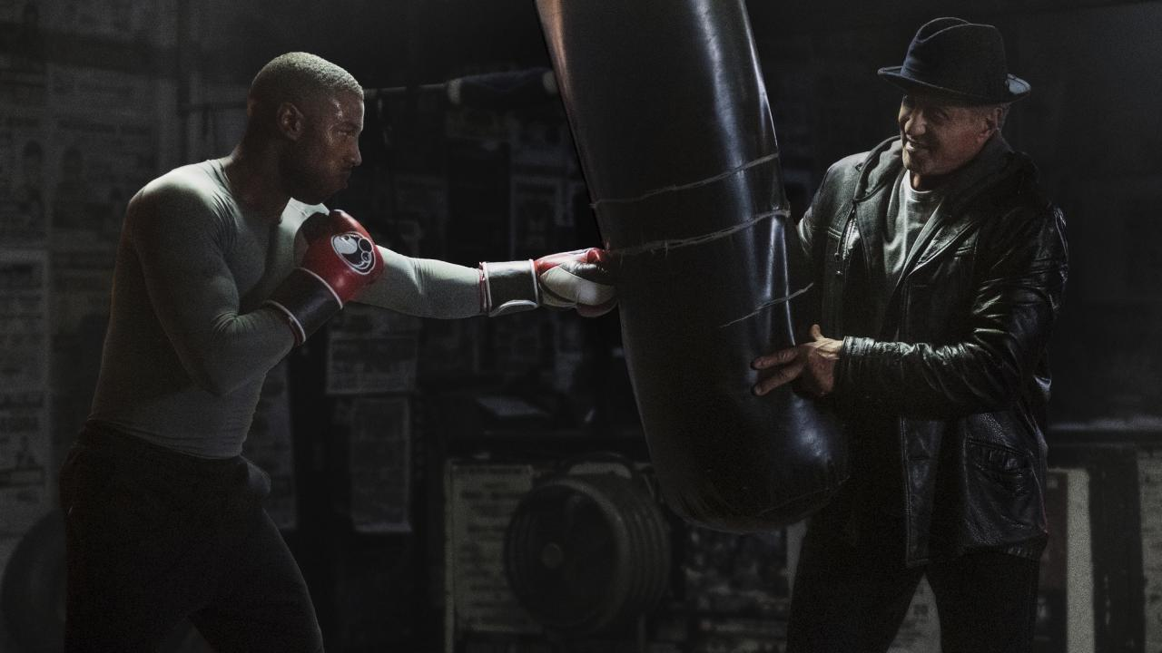 Michael B. Jordan, left, and Sylvester Stallone in a scene from Creed II.