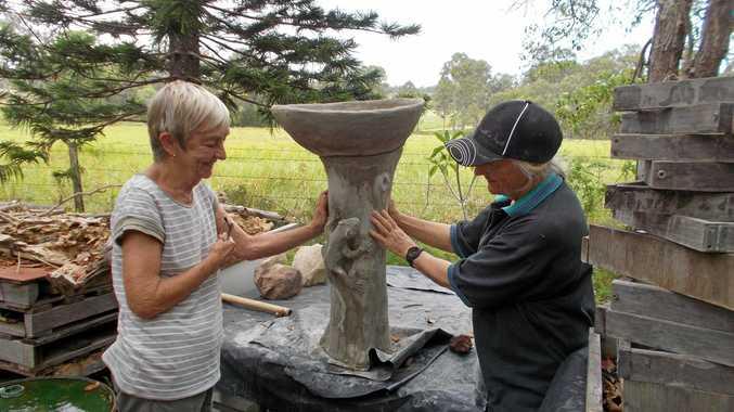 WORK IN PROGRESS: Sculpture Central members Monika Bayer (right) and Jennifer Ballard admire the progress of Eva Nieminen's latest work.