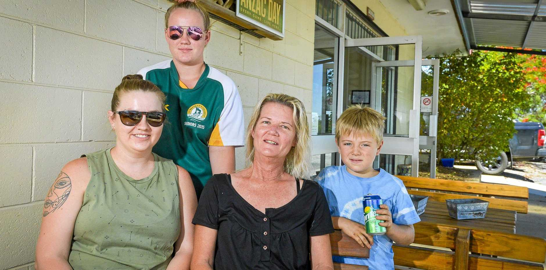 Ambrose resident Sarah Hargreaves and her son Ben (LEFT and RIGHT), evacuated to Raglan Tavern owned by Michelle Weir, pictured with her daughter Makenzey Weir.