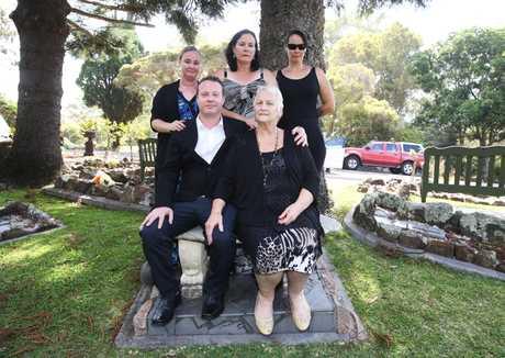 FAMILY: Some of Marie van Beers' family. Son Chris van Beers sitting next to Moya Reid, Marie's sister, plus Ms Reid's daughter, Martina Reid on far left at back.