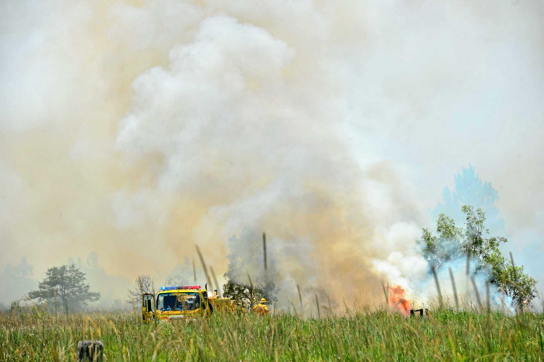 Fire crews battle a fire at Meridan Plains on Thursday.