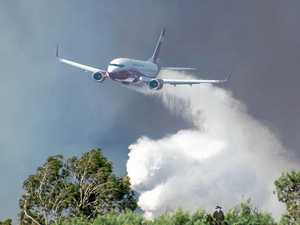 Six water bombers fly in to tackle bushfires