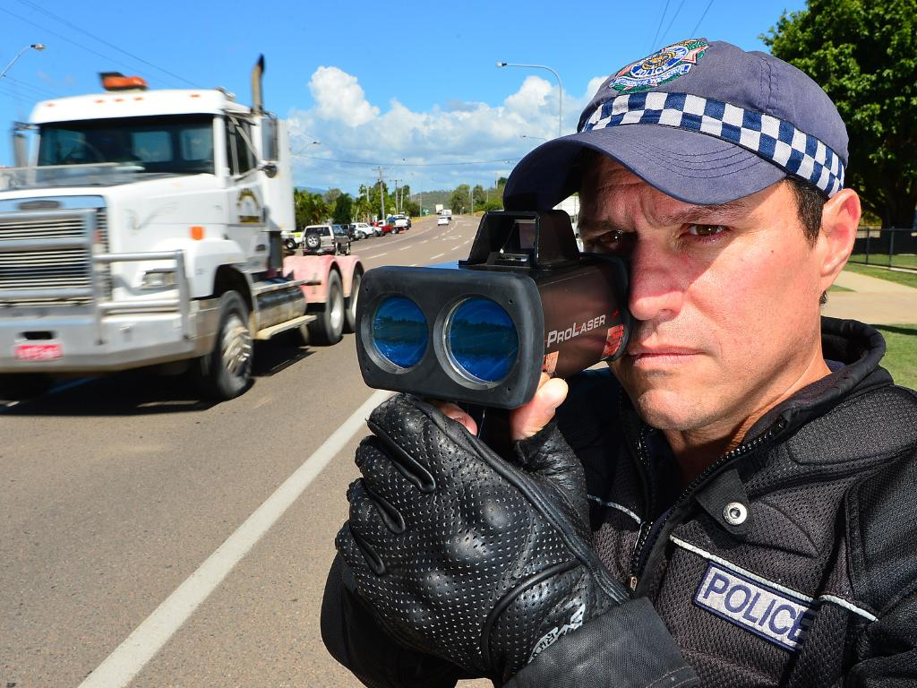 A Queensland police officer using a traditional Lidar gun.