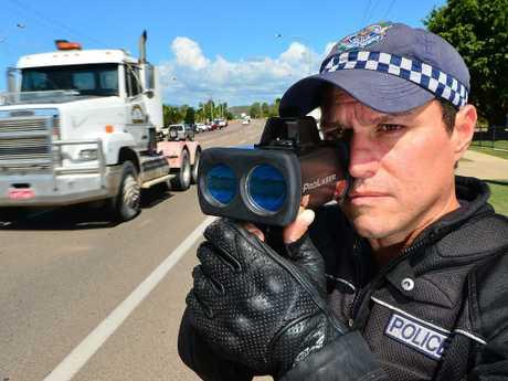 A Queensland police officer using a traditional Lidar gun.