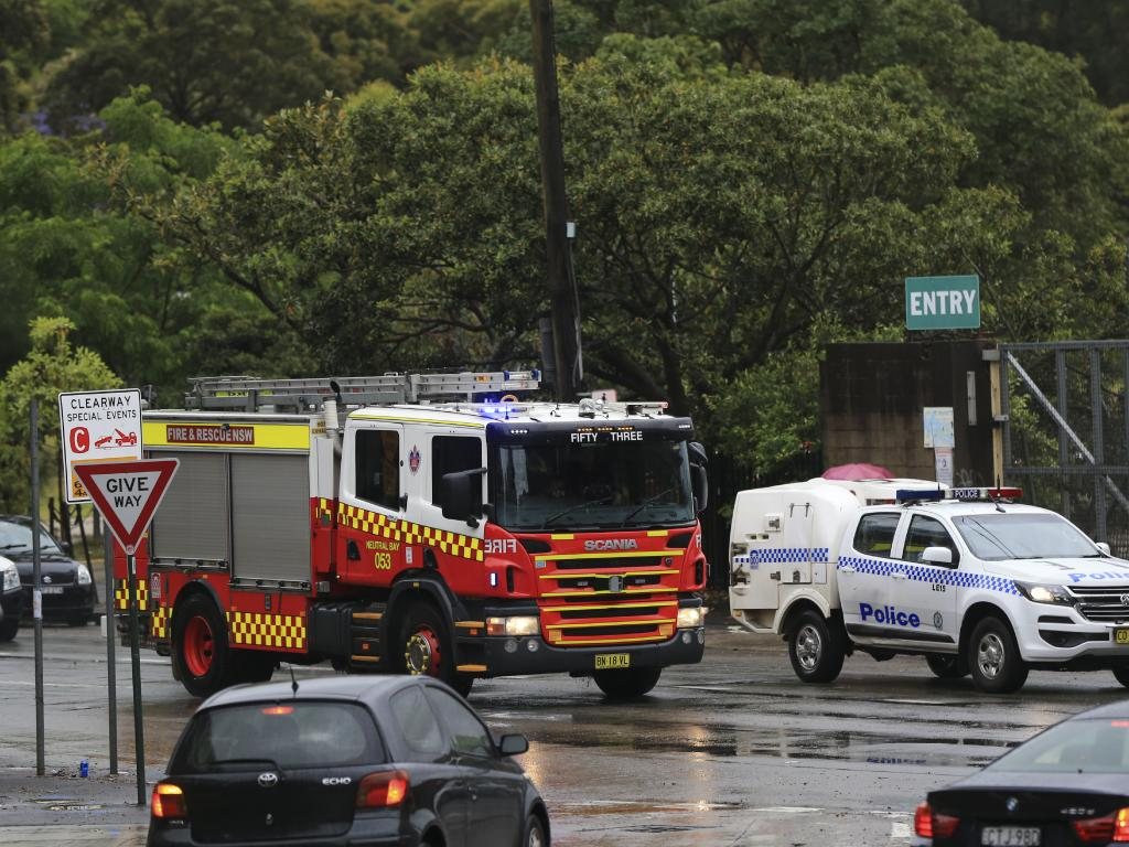 Emergency vehicles on Bridge Road, Glebe. Heavy rain and wind hits as Sydney endures bad weather. Picture: Dylan Robinson