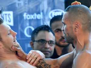 Chaos as Mundine attacks Horn at weigh-in