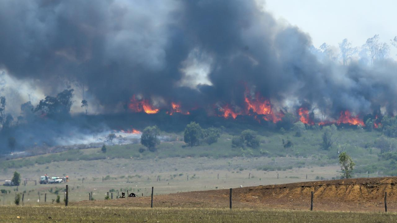A fire rages on a hill at Ambros in central Queensland. Picture: Mark Cranitch