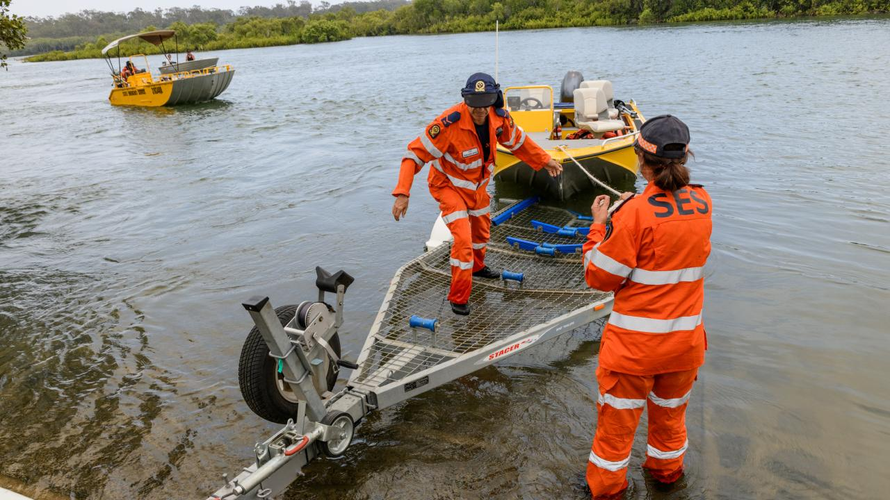 SES crews launch boats at Rocky Point to evacuate residents in Baffle Creek. Picture: AAP Image/Paul Beutel