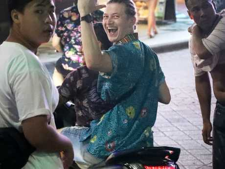 A young Australian without a helmet riding on a scooter in the nightclub district during schoolies, Kuta, Bali. Picture: Liam Kidston