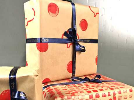 Go all out on the wrapping and be tight on the gifts, the Barefoot Investor suggests.