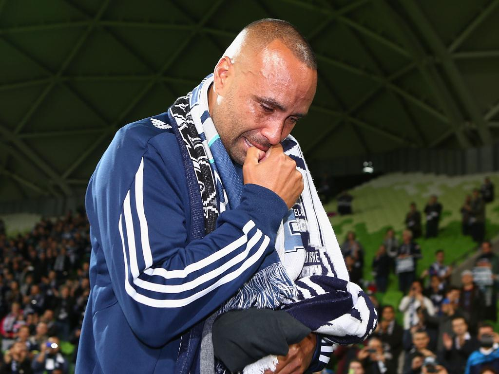Archie Thompson sheds tears as he's thanked by Melbourne Victory fans. (Photo by Robert Prezioso/Getty Images)