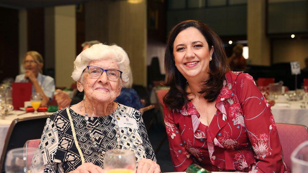 Queensland Premier Annastacia Palaszczuk with a member of the 100+ club.