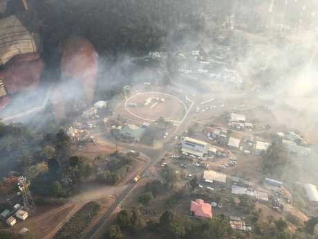 RACQ CQ Rescue has evacuated 10 people from Eungella tonight as a bushfire threatened the township and closed the Range Road.