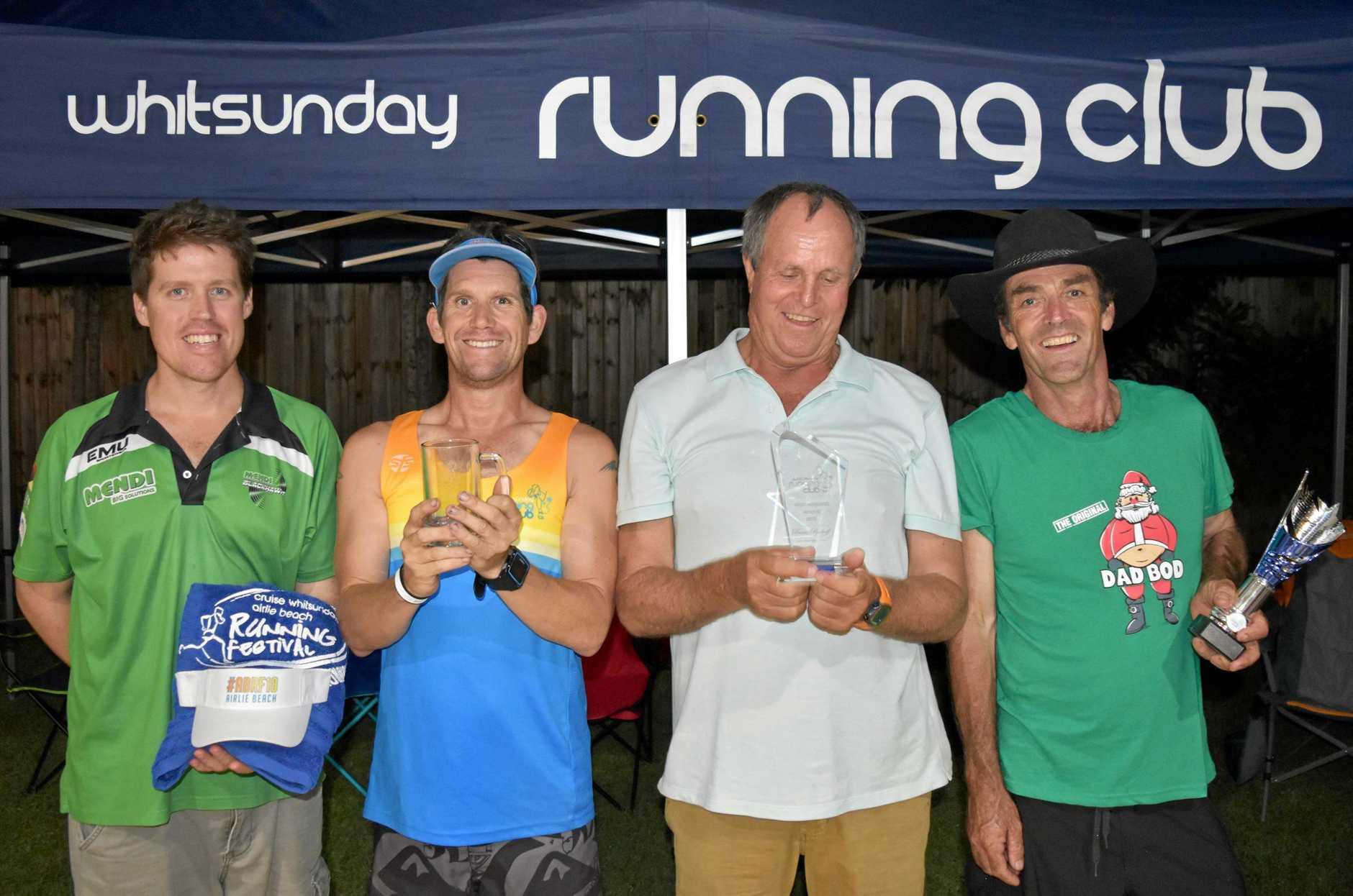 Whitsunday Running Club male award recipients Chris Harvey, Justin Knight-Gray, Bossie Boshoff and Geoffrey Fyvie.