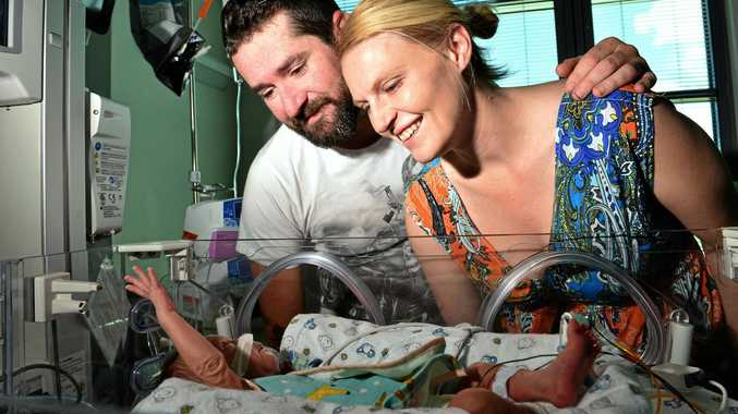 HI EVERYBODY: Premature baby Sullivan Codlin reaches out for his dad Jay Codlin and mum Jessica Cubitt at Sunshine Coast University Hospital yesterday.