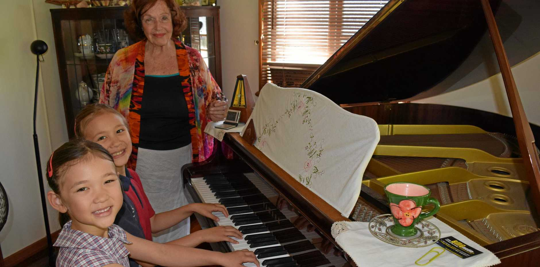Piano teacher Elizabeth Smith is proud her pupils Laura, 5 (left) and Emma Williams, 7 have been accepted into the Queensland Conservatorium Griffith University.