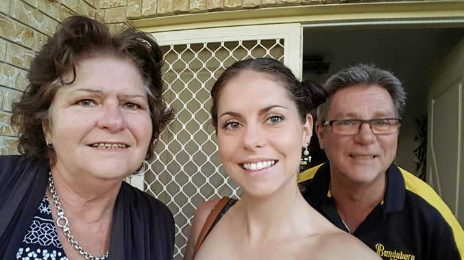 SURVIVOR: Lisa-Maree King relaxes with her parents Kim and Patrick King.