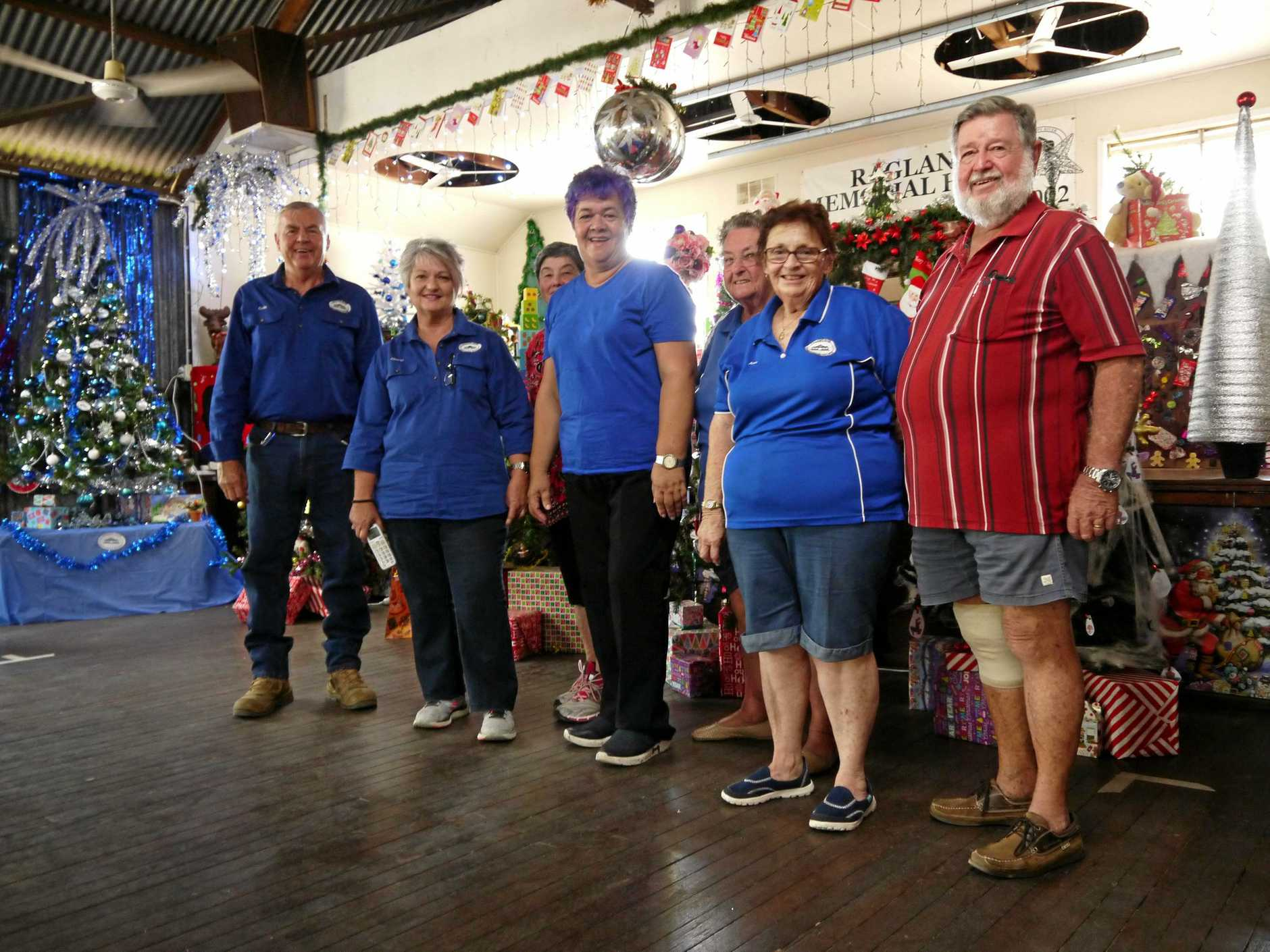 RECYCLED XMAS: L-R Colin and Cheryl Druery, Vivien Williams, Marcia Rickman, Ann Annand Lorraine Christopher Peter Annand at the Calliope Historical Village's recycled Christmas tree display.