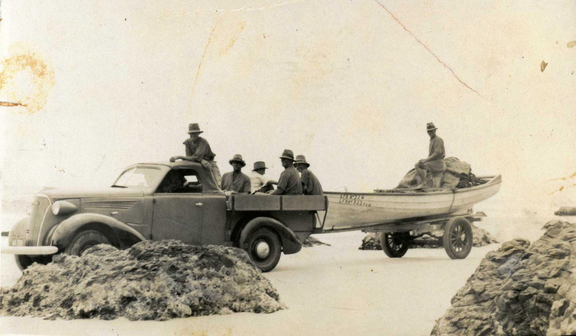 Boyd fishermen using the boat trailer, cira 1940s.