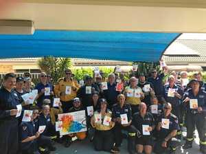 Smoky firefighter's hearts melt as Bundy kids deliver art