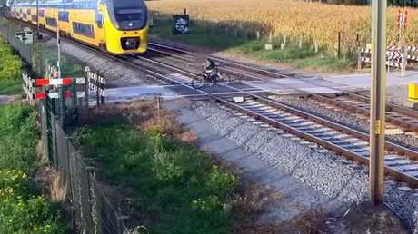 He soon realises, removes his left foot from the pedal and frantically pushes himself out of the way. Picture: ProRail/Youtube