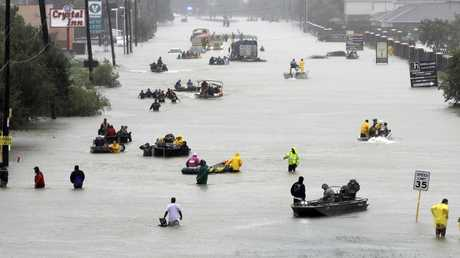 Floodwaters brought on by Tropical Storm Harvey in Houston. Scientists say climate change is faster, more extensive and worse than they thought a quarter century ago. Picture: AP