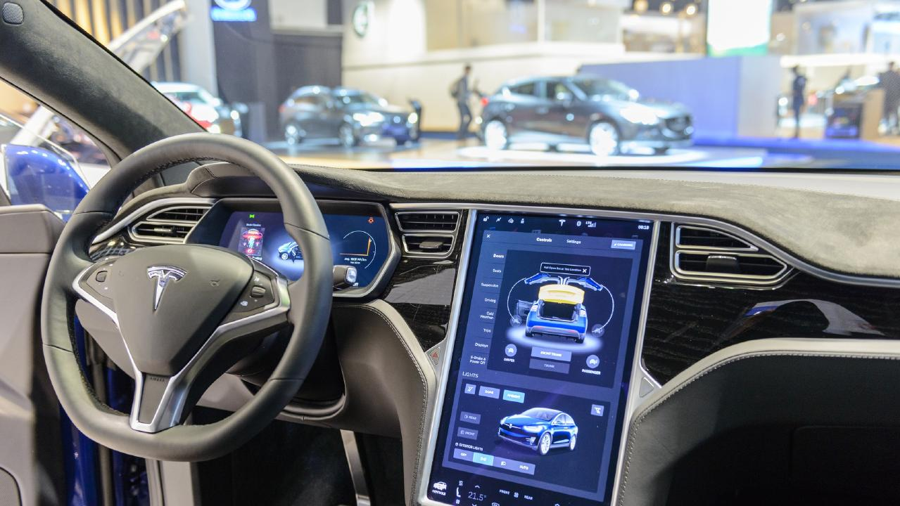 The digitised inteior of a Tesla . The extensive vehicle monitoring and tracking records of modern electric powered cars in China are being transmitted to the Communist government.