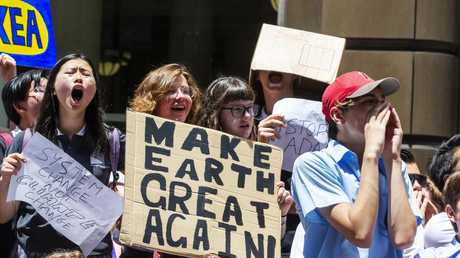 Placard-waving students demand action on climate change at Martin Place. Picture: Jenny Evans