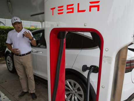 Shan Junhua chats about privacy near his white Tesla while charging it in Shanghai. When Shan bought his white Tesla Model X, he knew it was a fast, beautiful car. What he didn't know is that Tesla constantly sends information to the Chinese government. Picture: AP
