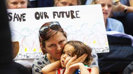 Mother and child at today's Sydney protest. Picture: Jenny Evans