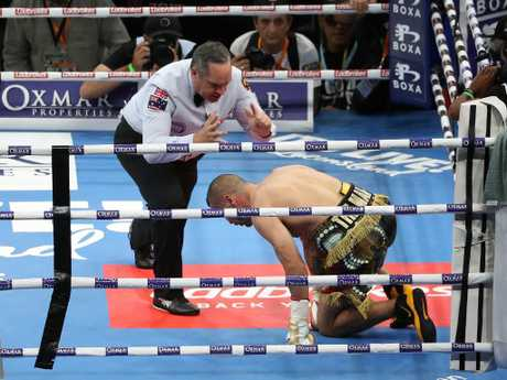 The referee counts out Mundine. Picture: Peter Wallis