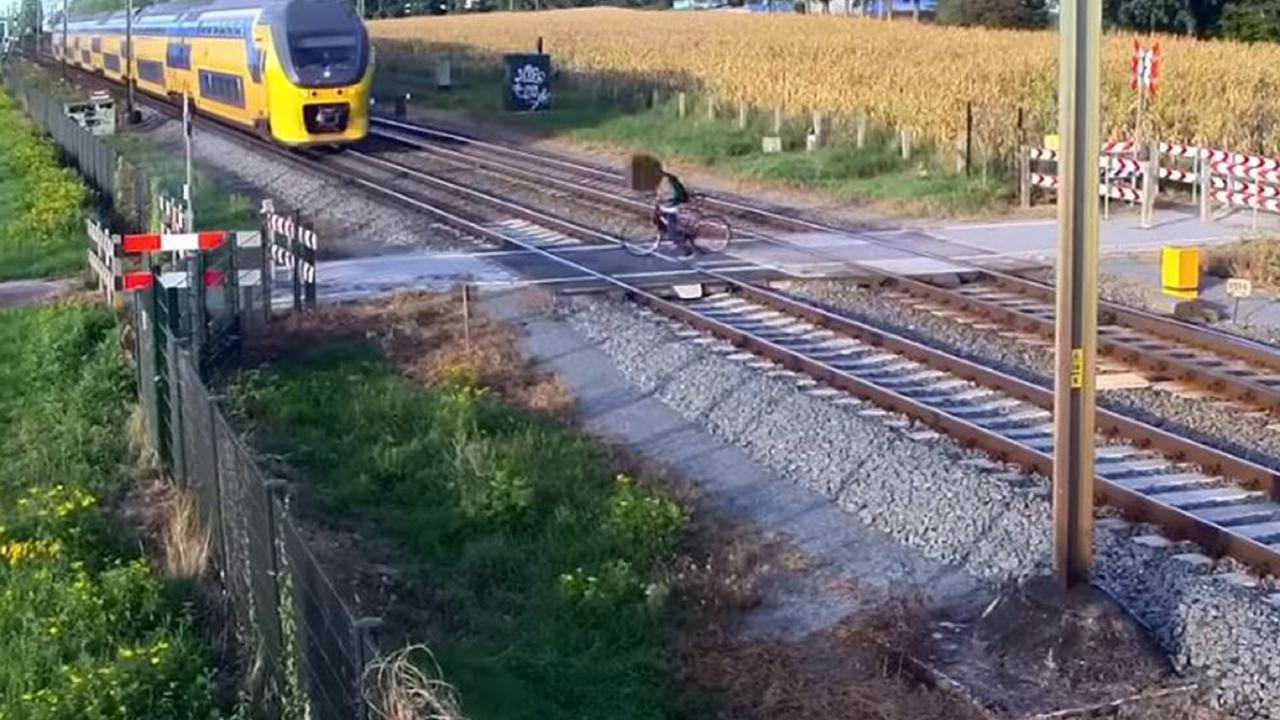 He then starts to cross the tracks, not realising another train was approaching. Picture: ProRail/Youtube