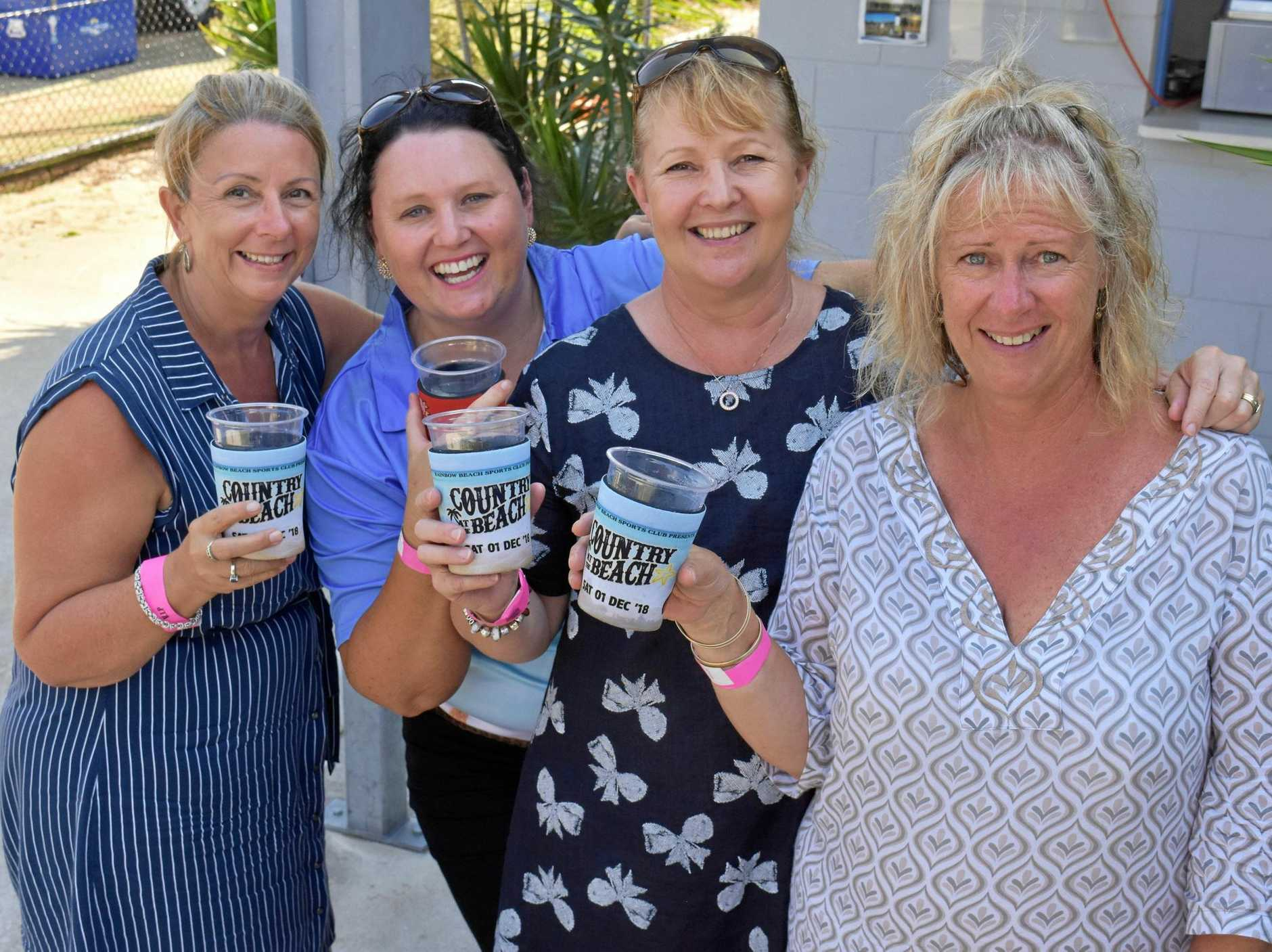 HERE TO STAY: Sue Paton, Tash Moffett, Helen Perrett and Karyn Jennings attended the 'Country at the Beach' event at Rainbow Beach.