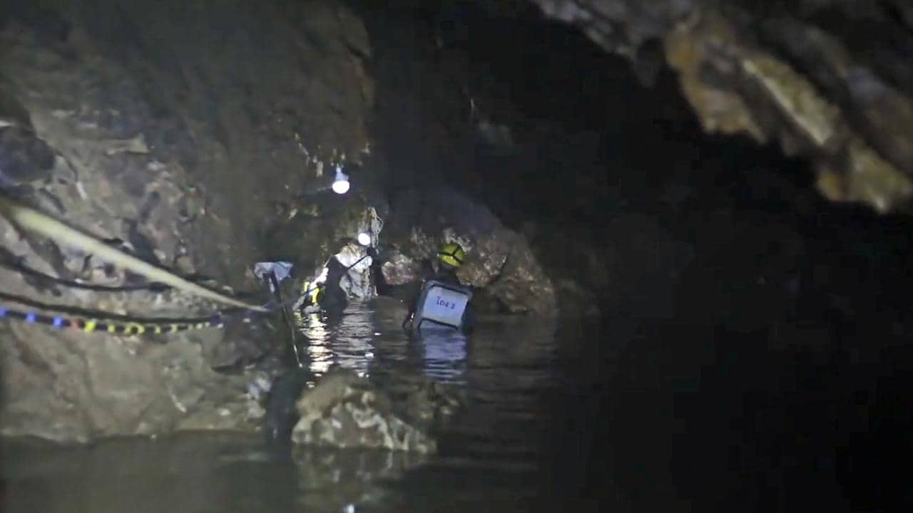 Rescuers battle rising water at Tham Luang cave in Khun Nam Nang Non Forest Park in Mae Sai district, Thailand, where 12 boys from a local football team and their coach became stuck. Picture: Thai Navy SEALS / Facebook