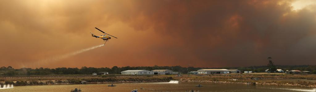 A water-bombing firefighting helicopters loaded with water at a local prawn farm at Baffle Creek, near Deepwater. Picture: Lyndon Mechielsen/The Australian