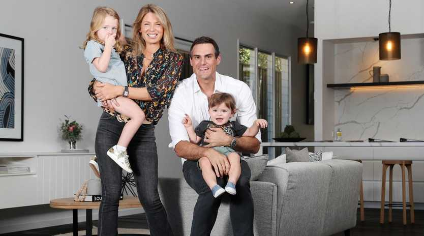 Former AFL player Jamie Charman with his wife Nicky and their children, Lenny, 3, and Joe, 18 months, at the New Farm house they are selling at auction. Picture: Tara Croser.