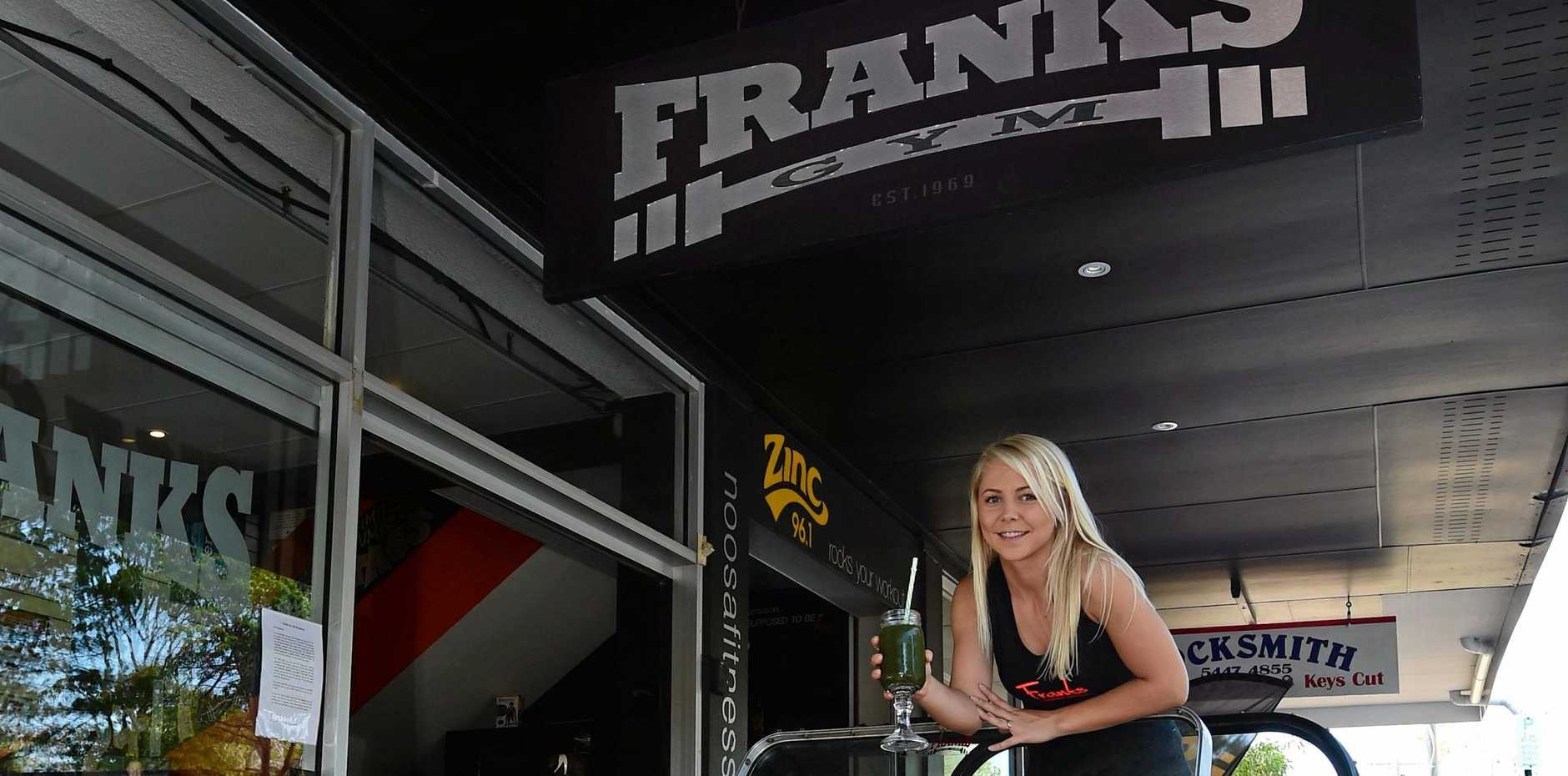 Amy and Kym Everett of Frank's Gym Noosa Junction in 2014, preparing for the gym to open 24 hours a day. It also started serving organic coffee and juice that year. Photo: Iain Curry / Sunshine Coast Daily