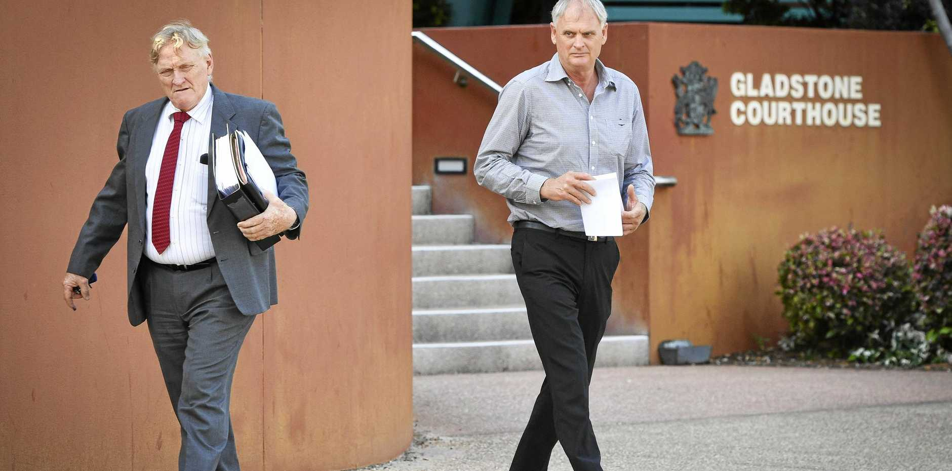 Gladstone Camping Centre owner Brett Bowman leaves court with consultant solicitor Barry Ross.