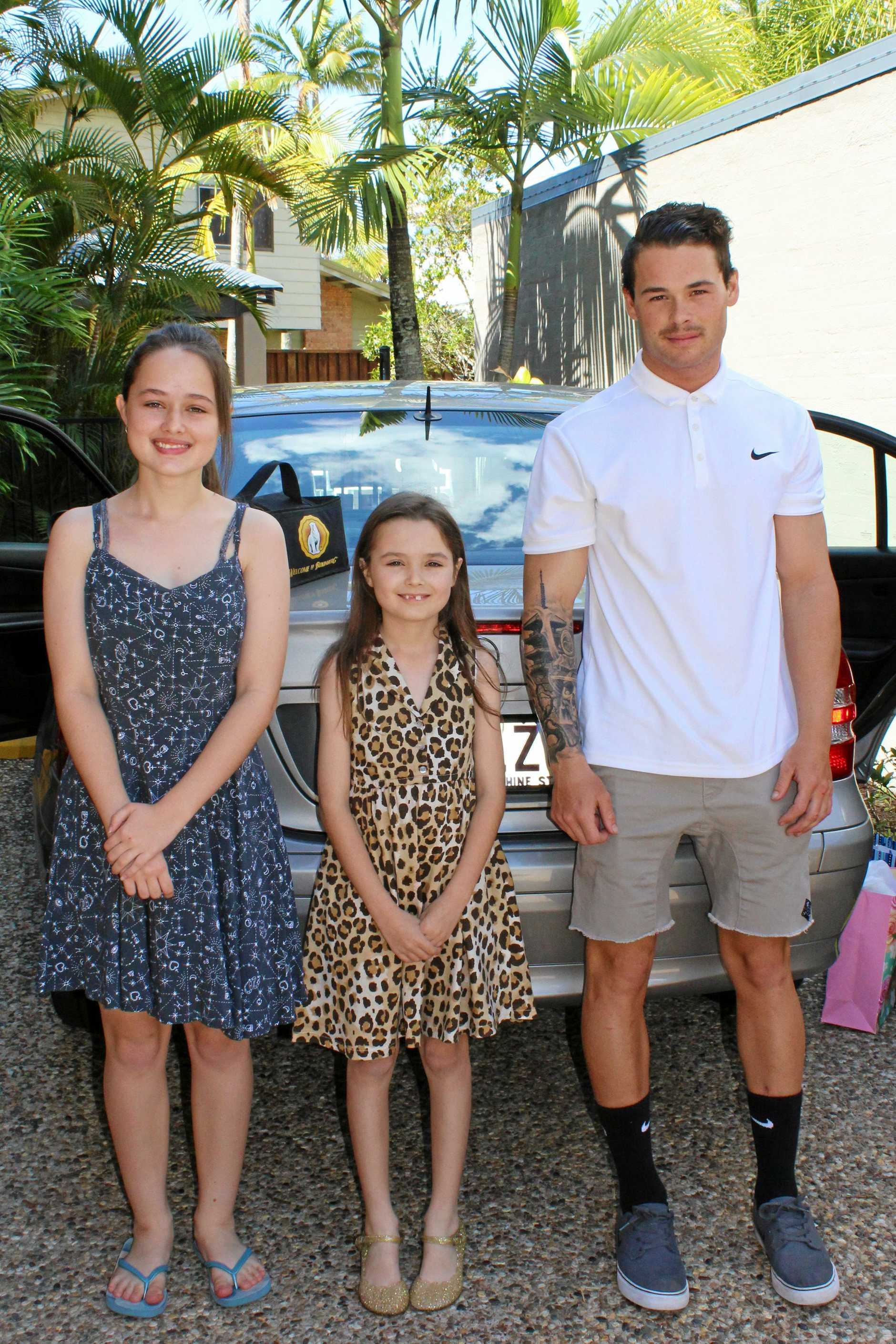 Former Sunshine Coast man Samuel King with his sisters Annalise (left) and Leticia.
