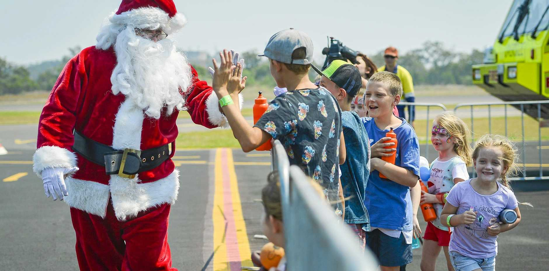 Santa's arrival via helicopter at Gladstone Airport Coropration's Santa from the Skies event.