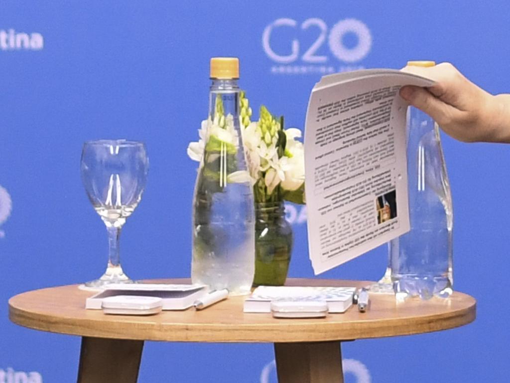 A mug shot of ScoMo can be seen on Ms Merkel's cheat sheet/ Picture: AAP