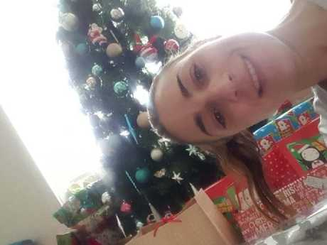 Wrapping Christmas presents is Samantha's happy place. Picture: Supplied